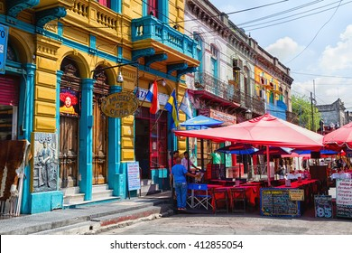 BUENOS AIRES - FEB 24: Colorful area in La Boca neighborhoods on February 24, 2016 in Buenos Aires. Street is a major tourist attraction & the area is filled with colorfully painted buildings.
