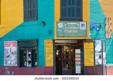 BUENOS AIRES - JANUARY 30, 2018: Colorful area in La Boca neighborhoods in Buenos Aires. Street is a major tourist attraction & the area is filled with colorfully painted buildings.