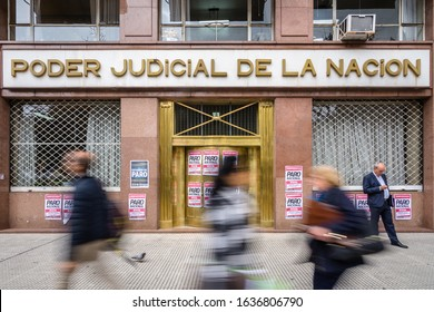 Buenos Aires/Argentina: August 2019: People Blurred from Motion and the External Facade of the Judiciary Power Building (Poder Judicial de La Nacion) in Downtown. Papers Announce a Strike Going On.