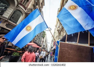 Buenos Aires/Argentina - August 28th 2019: National Flags of Argentina being Displayed as Souvenirs for Shoppers in Florida Street (Calle Florida), a Popular Touristic Shopping Destination in Downtown