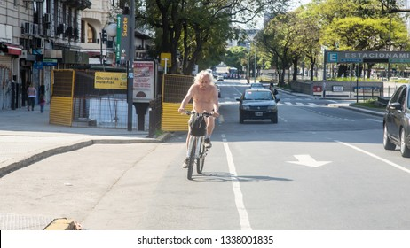 Buenos Aires/Federal District of Buenos Aires/Argentina - Out 14 2018: Cyclist walking on Av. 9 de Julio s / n corner with Av. Corrientes, C1043 CABA