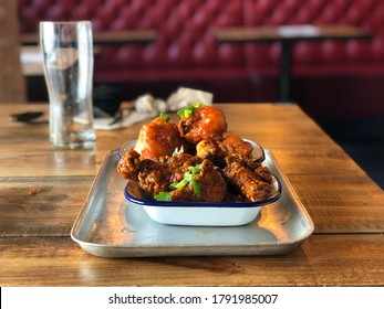 Buffalo Cauliflower and Chicken Wings in a restaurant