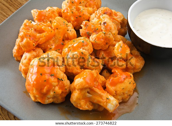 buffalo cauliflower with ranch dipping sauce close-up