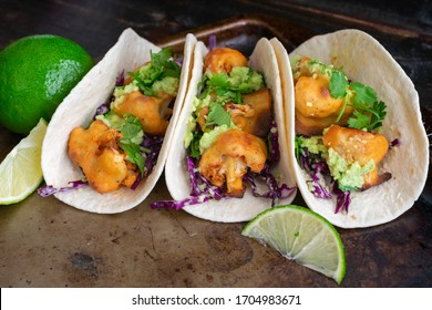 Buffalo Cauliflower Tacos with Avocado Crema: Vegetarian tacos made with spicy cauliflower, avocado crema, and shredded cabbage