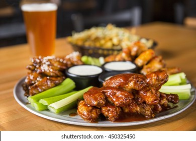 Buffalo Chicken Hot Wings with Ranch Sauce, Celery, and Beer