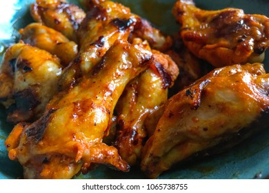 Buffalo chicken wings, cooked in a bbq grill and coated in a cayenne pepper buffalo sauce.