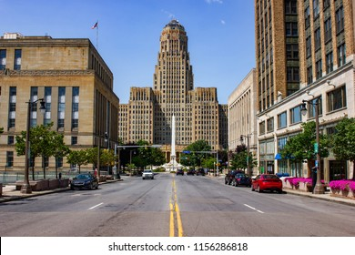 Buffalo City hall and Niagara Square  ( State of New York) view from court Street during day time from the middle of the road. Blue sky with almost no clouds and no cars driving by.
