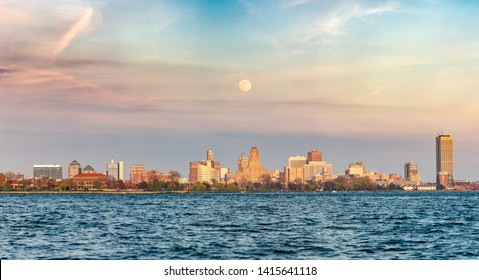 Buffalo, New York - May 17, 2019 : Panorama of a full moon rising over the Buffalo city skyline. Seen from Fort Eerie looking across the US/Canada border.