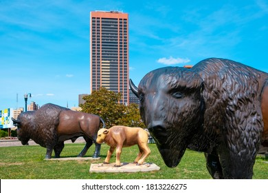 Buffalo, New York / USA - September 07 2020: Labor Day 2020 with Buffalo Statues in a park near the Buffalo waterfront and Downtown Buffalo, NY, in the background.