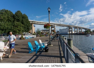 Buffalo, NY, USA, 09-16-2019: People walking along path at Buffalo harbor
