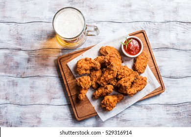 Buffalo style chicken wings served with cold beer, top view with copy space