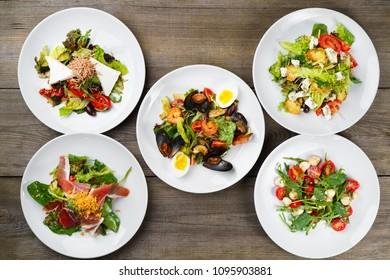 Buffet of delicious mediterranean salads flat lay. Top view on table with assortment of vegetable, seafood and meat meals. Banquet, menu, Italian food