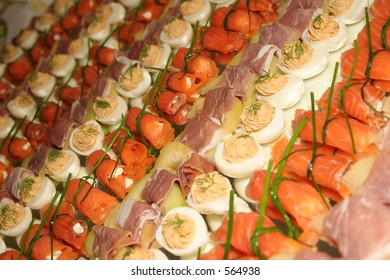 Buffet geometrically served with salmon, eggs and ham