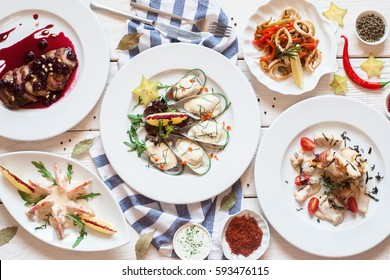 Buffet of luxurious mediterranean snacks flat lay. Top view on restaurant table with assortment of seafood meals. Banquet, menu, expensive food, success concept