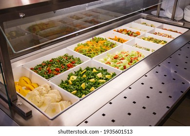 Buffet in restaurant, serving lunch or dinner for people to eat, diversity of delicious and tasty foods in a buffet, business food.