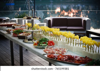 Buffet served table with snacks,fruits,canape,sweets and appetizers.Catering event plate service.Smorgasbord,food choice of breakfast in restaurant/Buffet line of lunch and dinner.Buffet self-service