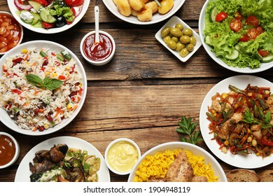 Buffet service. Frame of many  different dishes on wooden table, space for text