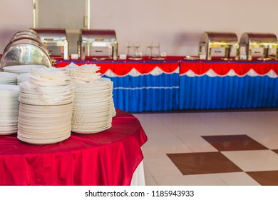 Buffet Setup with plates and dishes for the special events at the party Palace.Buffet Set up Concept.