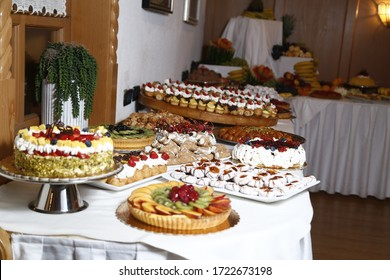 buffet with sweets. fruits and other sweets on dessert table. Rows of tasty looking desserts in beautiful arrangements. Sweets on banquet table - picture taken during catering event
