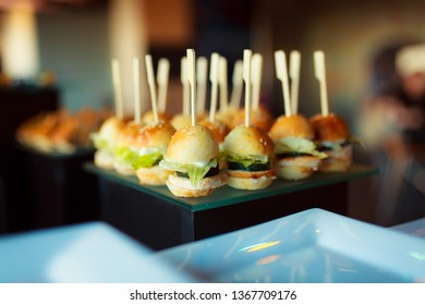 Buffet table. Banqueting hall. Catering. Portioned food. Snack menu. Mini dishes. Snacks on skewers.