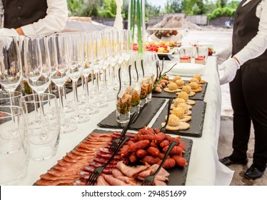 Buffet table close-up. Champagne glasses.