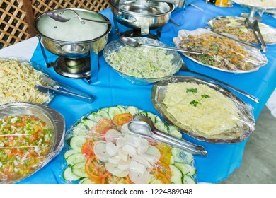 Buffet table with food to serve