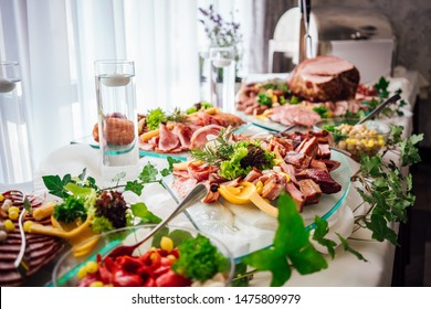 buffet table served by different canape, salads, sandwiches, snacks ready for eating in restaurant