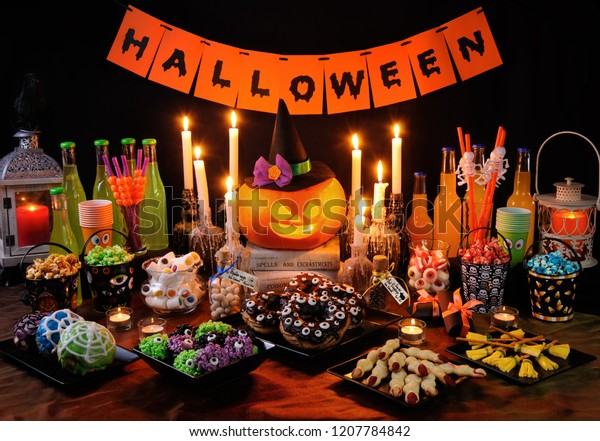 Buffet table with sweets and drinks, cooked  and decorated in honor of Halloween