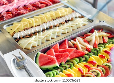 Buffet trays with a various delicious appetizers close-up. Breakfast in hotel. Smorgasbord.