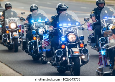 Buford, GA, USA - October 7, 2017:  Several motorcycle cops provide an escort to a group of motorcyclists about to start a charity bike ride on October 7, 2017 in Buford, GA.