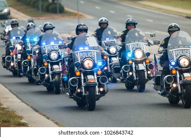 Buford, GA, USA - October 7, 2017:  Several police officers on motorcycles provide an escort to a group of motorcyclists about to start a charity bike ride on October 7, 2017 in Buford, GA.