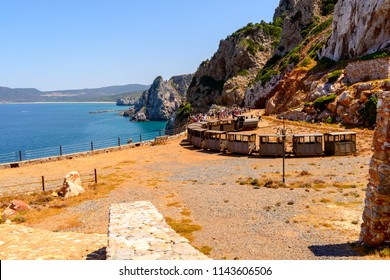 Buggerru, Sardinia, Italy - July 27, 2018: Every year, thousands of tourists from all over the world visit the Henry gallery and the panorama overlooking the high cliff overlooking the sea.