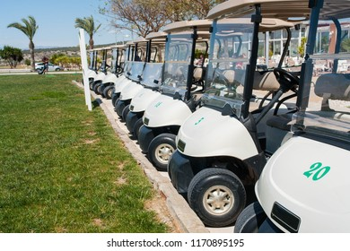 Buggies parked by the clubhouse in a golf course on the Costa Blanca in Spain