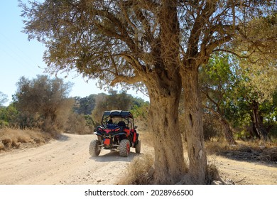 A buggy car on the sandy hills of Cyprus or Greek in summer. Outdoors adventure, extreme trip