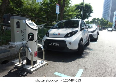 Bugis, Singapore - January 12, 2019 : View of a BlueSG ride sharing car  being park and charge at a charging station at Bugis, Singapore. It uses an all electric Bolloré Bluecar vehicle.
