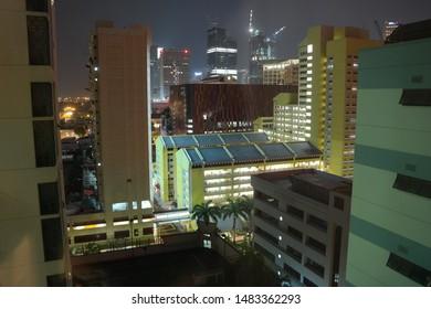 Bugis, Singapore / Singapore - November 8 2014: View to Queen St HDB , Bugis+ , and South Beach Tower under construction.