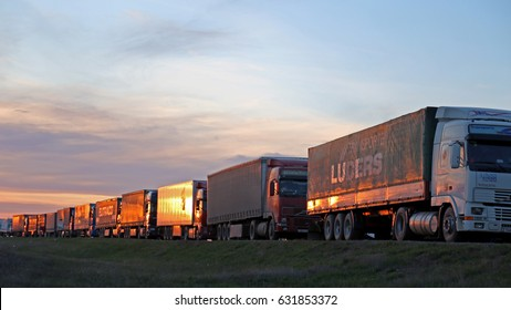Bugristoe, Russia - April 29, 2017: Lorry trucks cars in traffic jam at border zone custom. Customs post Bugristoe, Russian-Kazakhstan border zone