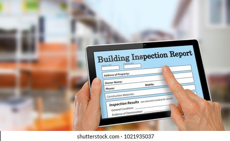 Buiding Inspector completing an inspection form on computer tablet
