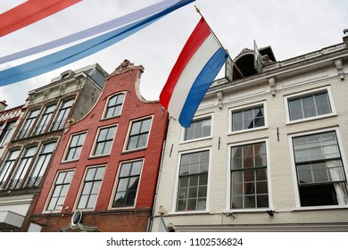 Buiding in Leeuwarden city center with a dutch flag hanging outside during a national holiday