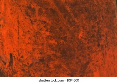 A build up of dirt on an orange safety cone yields this interesting grunge background