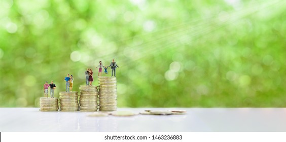 Build strong family relationship / strengthen family bonds concept : Young mature couple, parents, kid on steps of rising coins, depicts financial situtaion for newly wed couple, cost for having child