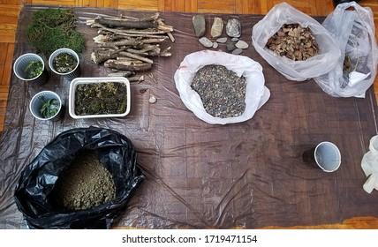 Build a terrarium - necessary supplies. Sticks, moss, dirt, gravel, stones,... In plastic bags and cups. DIY supplies.