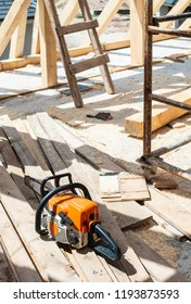 Build with wooden beams. Chainsaw