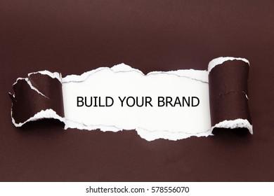 BUILD YOUR BRAND message written under torn paper.