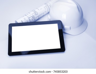 Builder architect using electronic tablet for blueprints