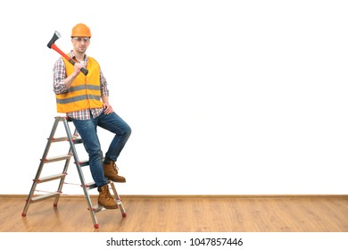 The builder with the ax standing on the ladder on the white wall background