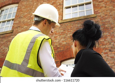 A builder, contractor or surveyor discussing a property quotation or contract with a homeowner. Part of a series with these models.