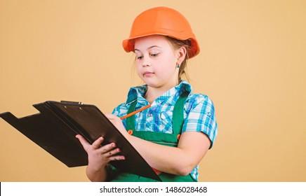 Builder engineer architect. Future profession. Kid builder girl. Build your future yourself. Initiative child girl hard hat builder worker. Child care development. Safety expert. Foreman planning.