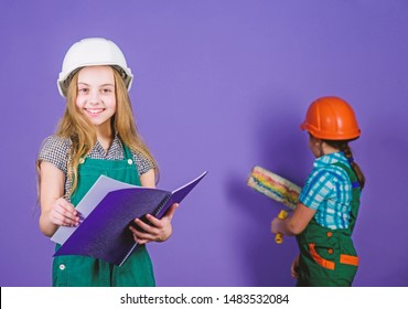Builder engineer architect. Kid worker in hard hat. Future profession. Tools to improve yourself. Repair. Child care development. small girls repairing together in workshop. violet background.