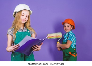 Builder engineer architect. Kid worker in hard hat. Child development. Tools to improve yourself. Repair. small girls repairing together in workshop. Future profession. Work for real professional.